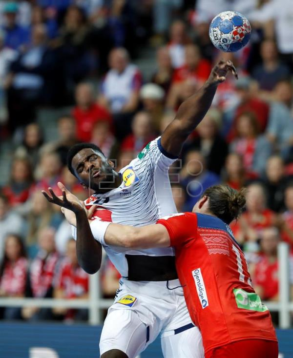 Dika Mem (L) of France in action against Kent Robin Tonnesen (R) of Norway during the EHF European Men's Handball Championship 2018 group match between Germany and Denmark in Porec, Croatia. EFE