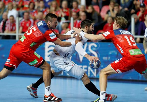 Nikola Karabatic (C) of France in action against Harald Reinkind (L) and Kristian Bjornsen (R) of Norway during the EHF European Men's Handball Championship 2018 group match between Germany and Denmark in Porec, Croatia. EFE