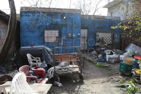 Maradona's childhood streets plagued by poverty and violence