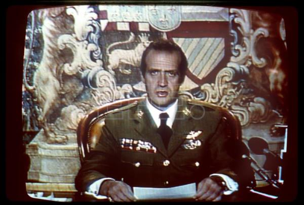 King Juan Carlos, in military attire, during the crucial emergency broadcast he made to the nation on the night of the failed military coup of Feb 23 1981, distancing the Crown from the putsch organizers, ordering them to stand-down and calling the constitutional order to be maintained . EFE-EPA(FILE)/ (IMAGEN TVE).