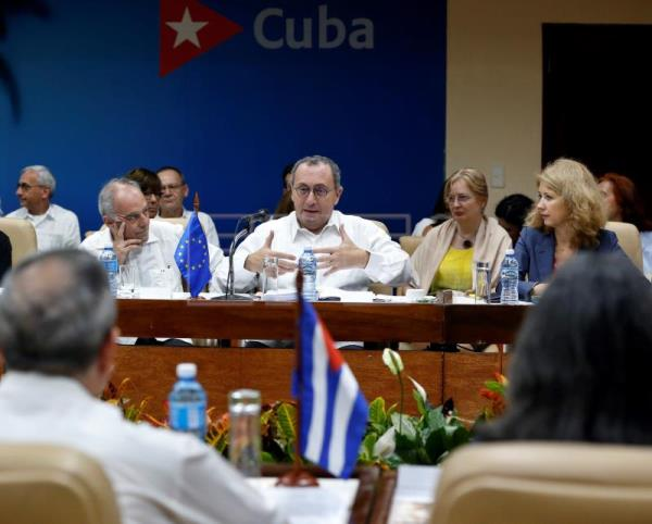 EU urges companies to counterattack US lawsuits on Cuba