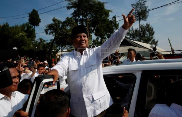Indonesian leader Joko Widodo leads presidential race, polls say