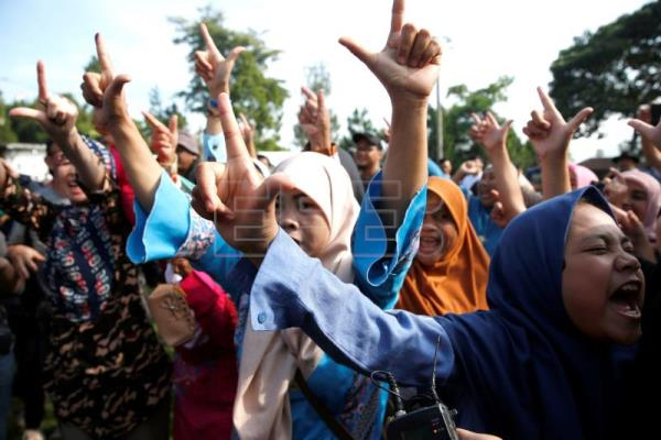 Polling stations open in Indonesia for world's largest single-day election
