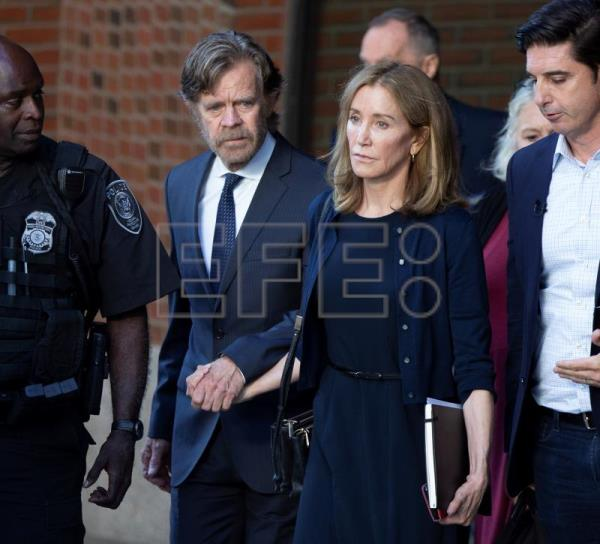 Felicity Huffman sentenced to 14 days in college admissions scandal