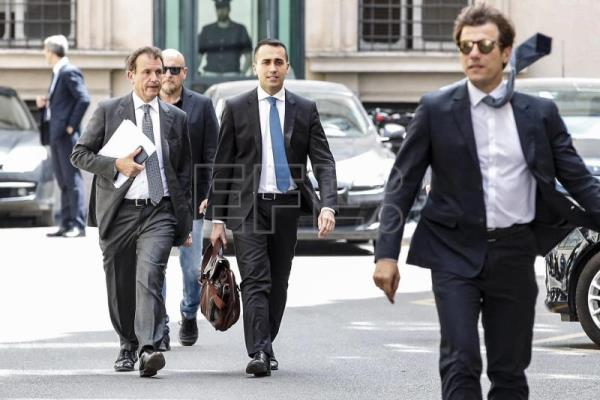 Labor and Industry Minister and Deputy Premier Luigi Di Maio (2-R) walks after a meeting with Italian Prime Minister Giuseppe Conte (not pictured) and Italian Minister of Interior and Deputy Premier Matteo Salvini (not pictured), at the Chigi Palace in Rome, June 12, 2018. EPA-EFE/GIUSEPPE LAMI