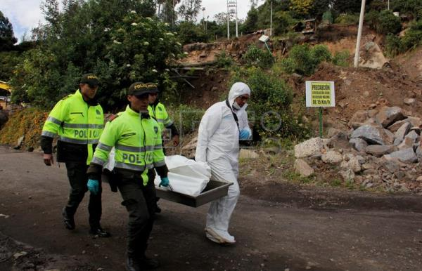 Photograph showing two police officers carrying the body of a victim of an earthquake in Pasto, Colombia, Jun 12, 2018. EPA-EFE/STR