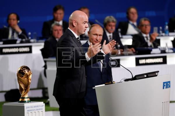 FIFA president Gianni Infantino (L) speaks after Russian President Vladimir Putin (R) addressed the delegates of the 68th FIFA Congress in Moscow, Russia, June 13, 2018. EPA-EFE/FELIPE TRUEBA