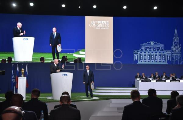 FIFA president Gianni Infantino (L) and Russian President Vladimir Putin (C) attend the 68th FIFA Congress in Moscow, Russia, June 13, 2018. EPA/ALEXEY NIKOLSKY