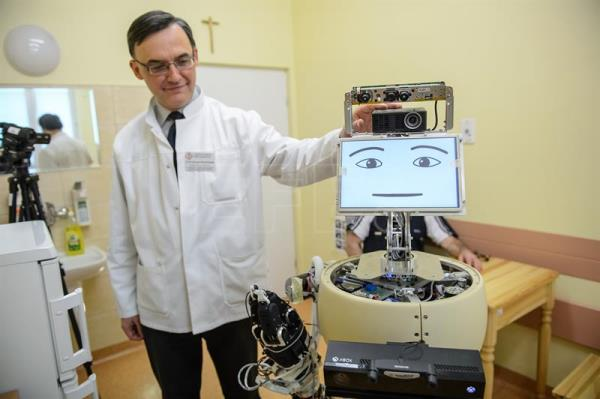 A file photograph showing the head of the neurology clinic of the Public Clinical Hospital No. 4 in Lublin, Professor Konrad Rejdak, presents the prototype robot designed for Alzheimer's patients in Lublin, east Poland, 09 February 2017. EPA/WOJCIECH PACEWICZ POLAND OUT
