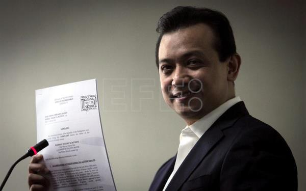 A handout photo released by the Philippine Senate-Public Relations and Information Bureau (PRIB) shows Filipino senator Antonio Trillanes IV holding documents as he speaking during a news conference at the Philippine Senate in Pasay city, south of Manila, Philippines, 16 February 2017. EPA/PRIB
