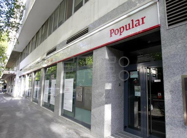 El banco santander compra por un euro el espa ol banco for Oficinas banco popular madrid
