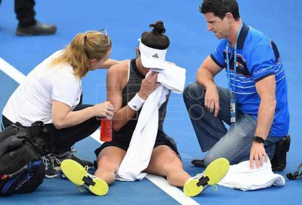 Garbiñe Muguruza of Spain is assisted from the court after sustaining an injury during her second round match against Aleksandra Krunic of Serbia at the Brisbane International Tennis tournament in Brisbane, Queensland, Australia, Jan. 2, 2018. EPA-EFE/DAVE HUNT EDITORIAL