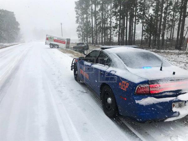 Photo made available by Georgia Department of Public Safety shows a Georgia State Patrol Dodge Charger at the scene of a crash involving a U-Haul trailer and pick-up truck on State Route 135 in Montgomery County near Uvalda, Georgia on 3 January 2018. EPA-EFE/GEORGIA STATE PATROL