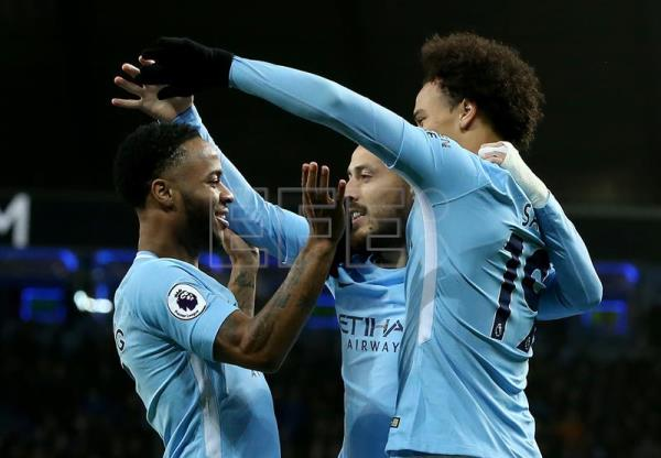Manchester City's Raheem Sterling (L) celebrates scoring during the English premier league soccer match between Manchester City and Watford at the Etihad Stadium in Manchester, Britain, Jan. 2, 2018. EPA-EFE/Nigel Roddis