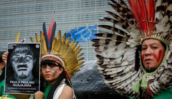 Members of Brazilian indigenous communities protest in front of EU Commission in Brussels
