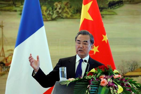 (FILE) Chinese Foreign Minister Wang Yi gestures while speaking during a joint news conference with French Foreign Minister Jean-Marc Ayrault (unseen) at the Ministry of Foreign Affairs, in Beijing, China, Apr. 14, 2017. EPA/WU HONG