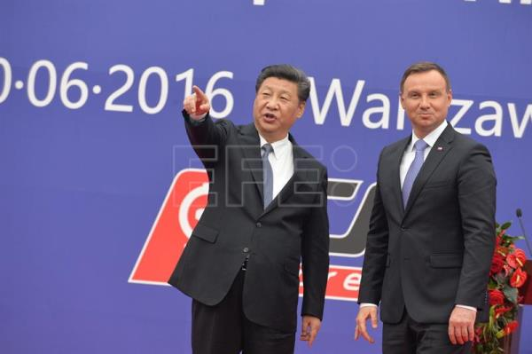 (FILE) Polish President Andrzej Duda (R) and Chinese President Xi Jinping (L), during the inauguration of the China Railway Express, a new railway line from China to Europe, on the sideline of the International Forum on the New Silk Road and the 4th Poland-China Regional Forum in Warsaw, Poland, 20 June 2016. EPA/MARCIN OBARA POLAND OUT