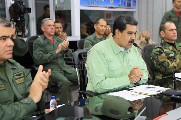 The office of Venezuelan President Nicolas Maduro provided this photo of the head of state accompanied by military officers during a meeting in Caracas on Thursday, Feb. 21. EFE-EPA/Prensa Miraflores/EDITORIAL USE ONLY