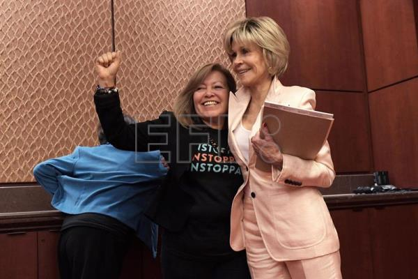 US actress and activist Jane Fonda (R) hugs worker Mily Trevino (L) during a conference organized by several women's associations at the US Congress in Washington, DC, United States, July 12, 2018. EPA-EFE/Lenin Nolly