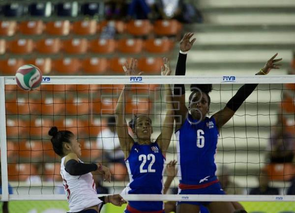 Colombia's Melissa Rangel (L) in action against Cuba's Egli Sabin and Daymara Lescay, during a Women's Pan-American Volleyball Cup match between Cuba and Colombia in Santo Domingo, Dominican Republic, July 12, 2018. EPA-EFE/Orlando Barria