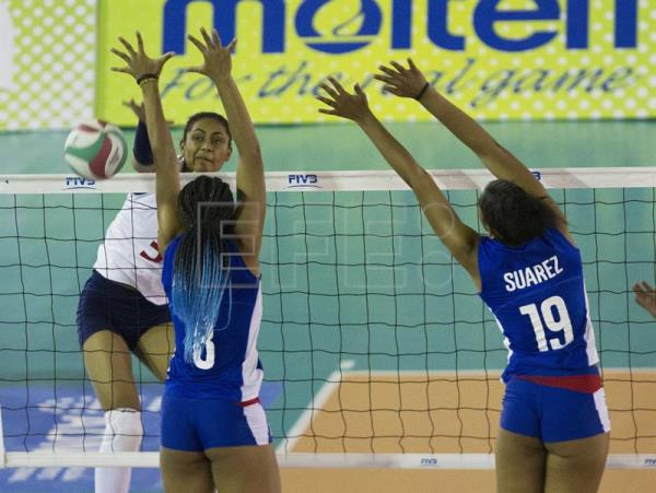 Dayana Segovia (L) of Colombia in action against Diaris Perez (C) and Laura Suarez of Cuba, during a Women's Pan-American Volleyball Cup match between Cuba and Colombia in Santo Domingo, Dominican Republic, July 12, 2018. EPA-EFE/Orlando Barria