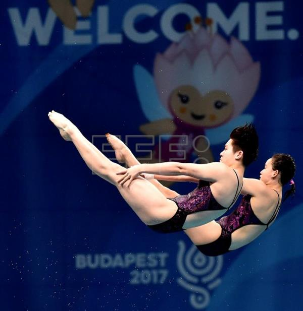 Qian Ren and Yajie Si of China compete in women's diving 10m synchro platform final of FINA Swimming World Championships 2017 in Duna Arena in Budapest, Hungary, 16 July 2017. EFE