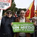 A demonstrator holds a placard reading 'Stop Sanchez. Election Now!' (L) and another a banner reading 'Go On Spaniards. Scared of Nothing and No One' as several people waving Spanish national flags wait for the start of a rally, called by Spanish opposition parties People's Party and Ciudadanos (Citizens) party under the motto 'For an United Spain. Election Now!', to ask for general election in Madrid, Spain, Feb. 10, 2019. EPA-EFE/VICTOR LERENA