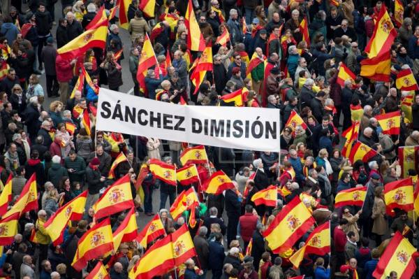 People hold a banner reading 'Sanchez Resign' at Columbus Square to take part in a rally, called by Spanish opposition parties People's Party and Ciudadanos (Citizens) party under the motto 'For an United Spain. Election Now!', to ask for general election in Madrid, Spain, Feb. 10, 2019. EPA-EFE/LUCA PIERGIOVANNI