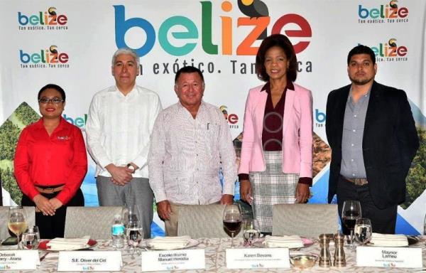Belizean Tourism and Aviation Minister Manuel Heredia (C); Belizean Amabassador to Mexico Oliver del Cid (2nd-L); Belize Tourism Board (BTB) director Karen Bevans (2nd-R); Senior Travel Trade Officer Deborah Gilharry Arana (L); and Digital Marketing Manager Maynor Larrieu (R) pose during a tourism promotion event on Feb. 9, 2019, in Mexico City, Mexico. EPA-EFE/Ana Lopez