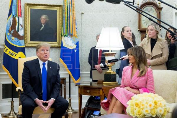 US President Donald J. Trump (L) and US first lady Melania Trump (R) attend a meeting with their Colombian counterparts in the Oval Office of the White House in Washington, DC, USA, on Feb. 13, 2019. EPA-EFE MICHAEL REYNOLDS