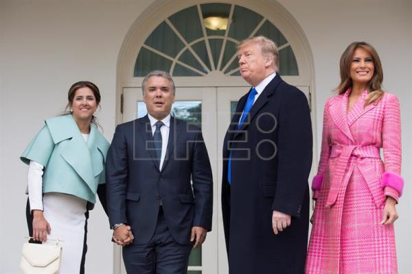 US President Donald J. Trump (2-R) and US first lady Melania Trump (R) stand with the president of Colombia, Ivan Duque (2-L), and his wife, Maria Juliana Ruiz Sandoval (L), in the Rose Garden of the White House in Washington, DC, USA, on Feb. 13, 2019. EPA-EFE/MICHAEL REYNOLDS