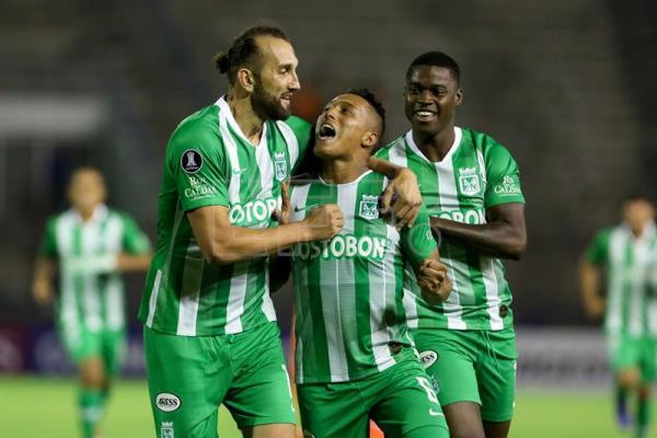 Atletico Nacional's Sebastian Gomez (center) celebrates after scoring a goal during a Copa Libertadores second-stage match against Deportivo La Guaira on Feb. 7, 2019, in Caracas. EPA-EFE/Cristian Hernandez