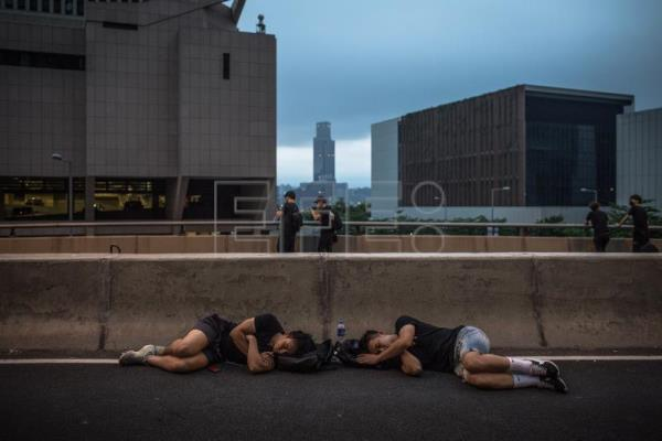 Protesters call for a complete withdrawal of the extradition bill in Hong Kong
