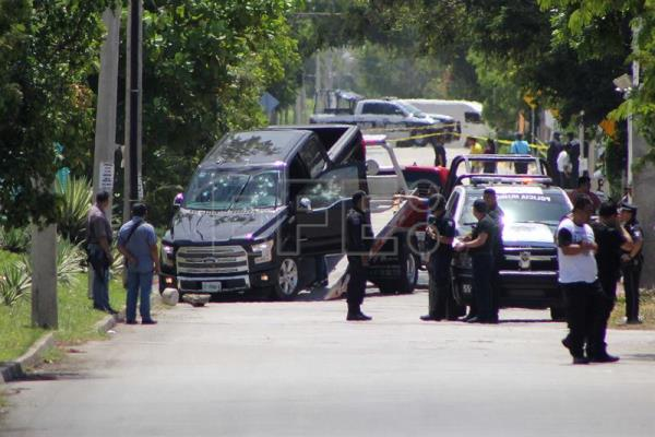 View of the vehicle in which were killed the head of government of the Mexican state of Quintana Roo Isaías Capeline Lizárraga and his escort Angel Casillas for a shooting attack in the city of Cancun, Mexico, on 14 July 2016. EPA/Alonso Cupul