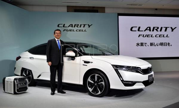 Honda Motor Co President And CEO Takahiro Hachigo Poses Next To The All New