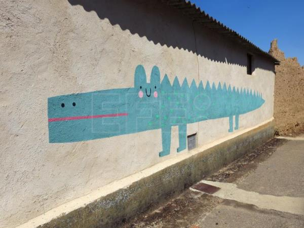 Graffiti artists transform remote village into urban art hub