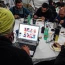Venezuelan scientist Juan Manuel Carrera (L) works on his laptop next to a group of explorers during lunch time in a communal area in the Glaciar Union camp in the Ellsworth Mountains, Antarctica, Nov. 30, 2018. EPA-EFE/FELIPE TRUEBA