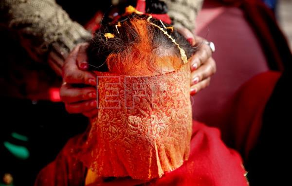 (FILE) A Nepalese girl from the Newari community dressed as bride takes part in the ceremony 'Bel Bibaha or Ehee' in Kathmandu, Nepal, 16 December 2015. Thirty-seven percent of Nepali girls get married before reaching the age of 18, and 10 percent before 15, according to a report published 08 September 2016 by Human Rights Watch (HRW), which urges the government to take steps against the illegal practice of child marriage. EPA/NARENDRA SHRESTHA