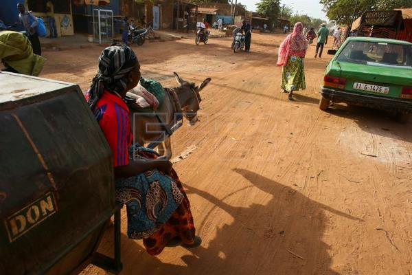 An archive photograph from March 1, 2013 shows women from Burkina Faso driving a donkey cart down a road in Ouagadougou, Burkina Faso. Burkina Faso authorities banned donkey exports to China, a government spokesman told EFE on Thursday. EPA/NIC BOTHMA