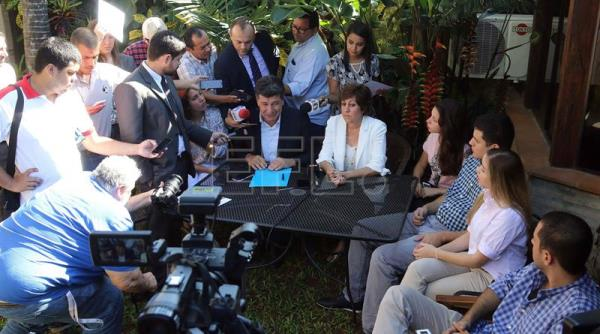 Paraguayan presidential candidate Efrain Alegre (L) and his wife Mirian Irun offer a press conference in Asuncion, Paraguay, April 11, 2018. EPA-EFE/Andres Cristaldo