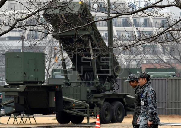 (FILE) Military personnel walk past Japan's Ground Self-Defense Force Patriot Advanced Capability-3 (PAC-3) missile interceptor unit deployed to counter North Korea's launch of ballistic missile at the Defense Ministry in Tokyo, Japan, 06 March 2017. EPA/FRANCK ROBICHON