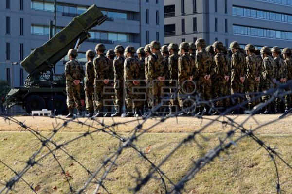 (FILE) Japanese military personnel stand in front of Patriot Advanced Capability (PAC-3) surface-to-air missile units at the Defense Ministry in Tokyo, Japan, 07 December 2012. EPA/FRANCK ROBICHON
