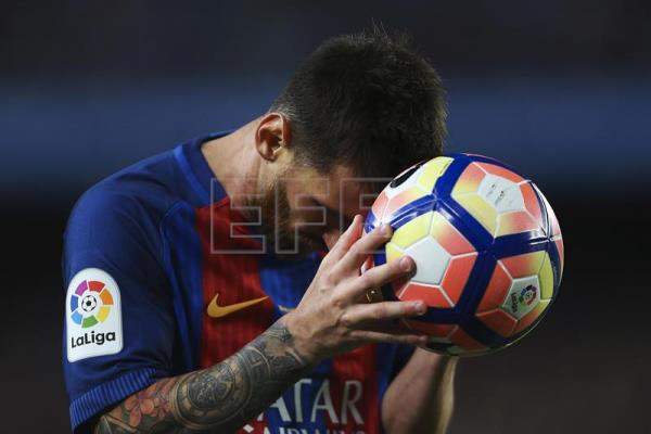 Archive image showing Barcelona's player Leo Messi reacting during the LaLiga soccer match between FC Barcelona and SD Eibar, at the Camp Nou, in Barcelona, Spain, May 21, 2017. EPA/Toni Albir