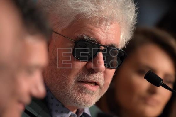 Almodovar gets carried away in Cannes by emotion, memories and kisses