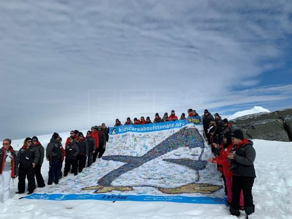 "Photo taken Jan. 6, 2019, showing members of the Homeward Bound expedition posing on Antarctica's Hydrurga Island in front of a huge banner sewn by hand by Australian geographer Marji Puotinen incorporating drawings done by about 1,000 children from all over the world for the contest she devised called ""Kids Care About Climate Change."" EFE-EPA/Diana Marcela Tinjaca"