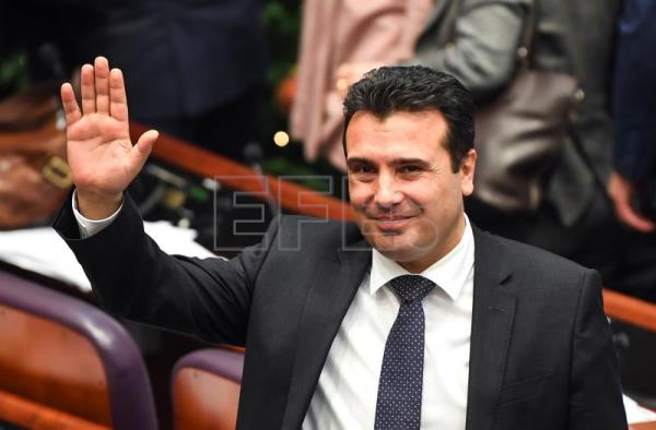 Prime Minister Zoran Zaev waves to journalists after a parliamentary vote to change the country's constitutional name in Skopje, Northern Macedonia, Jan. 11, 2019. EPA-EFE/GEORGI LICOVSKI