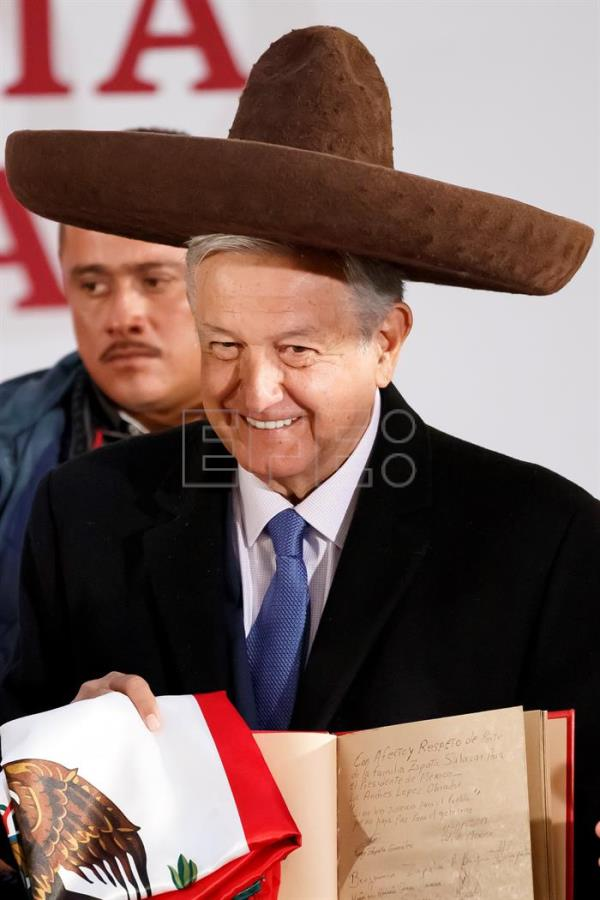 Mexican President Andres Manuel Lopez Obrador wears a Mexican sombrero given him by descendants of the revolutionary Emiliano Zapata on Jan. 11, 2019, at a press conference in Mexico City where he announces a new program of aid for disabled persons. EFE-EPA/Jose Mendez