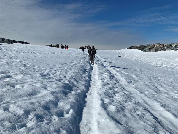 Photo taken Jan. 6, 2019, showing members of the Homeward Bound expedition walking through the snow on Antarctica's Hydrurga Island. EFE-EPA/Diana Marcela Tinjaca