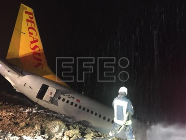 A Boeing 737-800 passenger plane of Pegasus Airlines is seen crashed after going off the runway at Trabzon Airport in Trabzon, Turkey, 14 January 2018. EFE