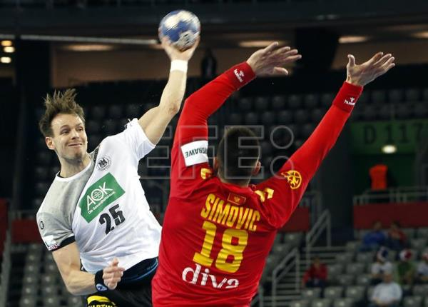 Kai Hafner (L) of Germany in action against Nebojsa Simovic (R) of Montenegro during the EHF European Men's Handball Championship 2018 group C match between Germany and Montenegro in Zagreb, Croatia. EFE